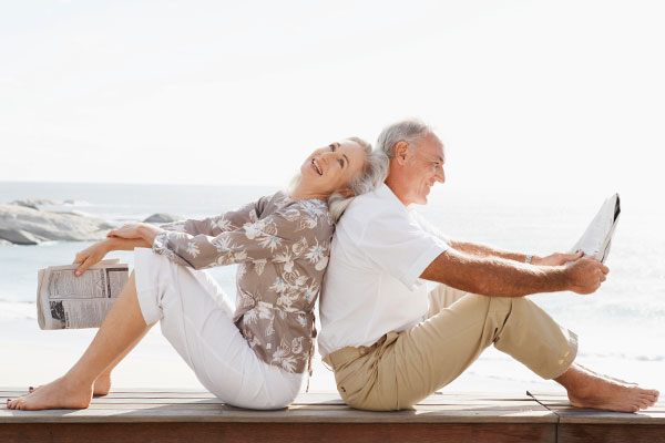 Elderly couple sitting on a deck